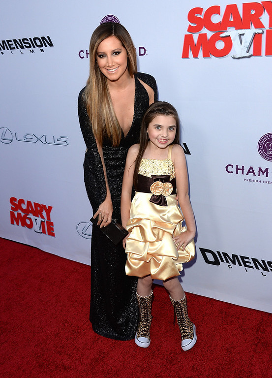 ". Actresses Ashley Tisdale (L) and Gracie Whitton arrive at the Dimension Films\' ""Scary Movie 5\"" premiere at the ArcLight Cinemas Cinerama Dome on April 11, 2013 in Hollywood, California.  (Photo by Jason Merritt/Getty Images)"