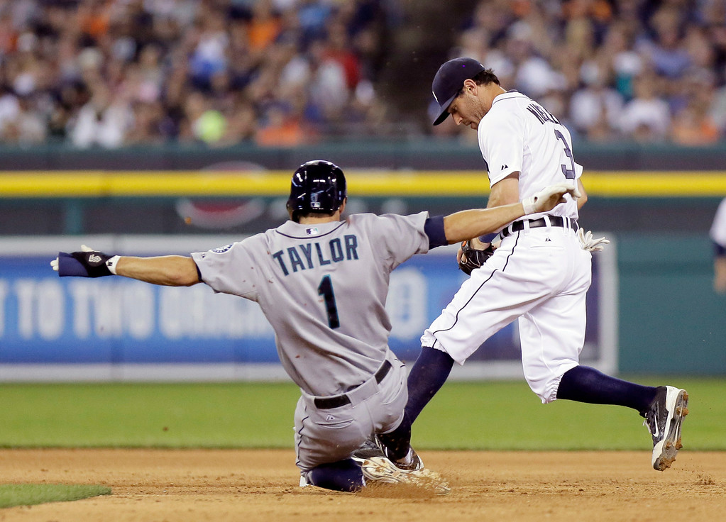 . Detroit Tigers second baseman Ian Kinsler, right, beats Seattle Mariners\' Chris Taylor to the bag to make an out during the eighth inning of a baseball game Saturday, Aug. 16, 2014, in Detroit. The Tigers defeated the Mariners 4-2. (AP Photo/Duane Burleson)
