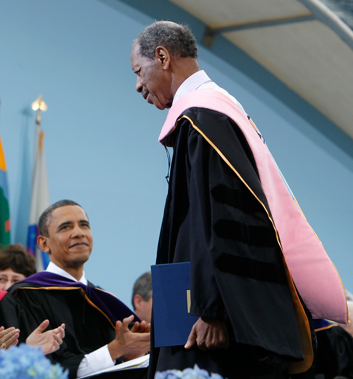 . Jazz musician Ornette Coleman, right, walks back to he seat after receiving an honorary Doctor of Music degree as President Barack Obama looks on at the University of Michigan commencement ceremony in Ann Arbor, Saturday, May 1, 2010. (AP Photo/Charles Dharapak)