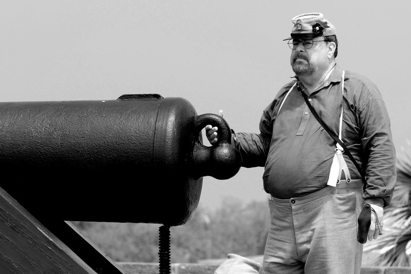 """Reenactor Private George Bragdon stands ready to """"fire"""" a Model 1841 32-pound smooth bore canon at Ft. Moultrie in Sullivan's Island, South Carolina on Monday, April 11, 2011. ..The 150th Anniversary of the Firing on Ft. Sumter was commemorated with lectures, performances, demonstrations, and a living history throughout the area on James Island, Charleston, Mt. Pleasant, and Sullivan's Island during the week from April 8-14, 2011. Photo Copyright 2011 Jason Barnette"""