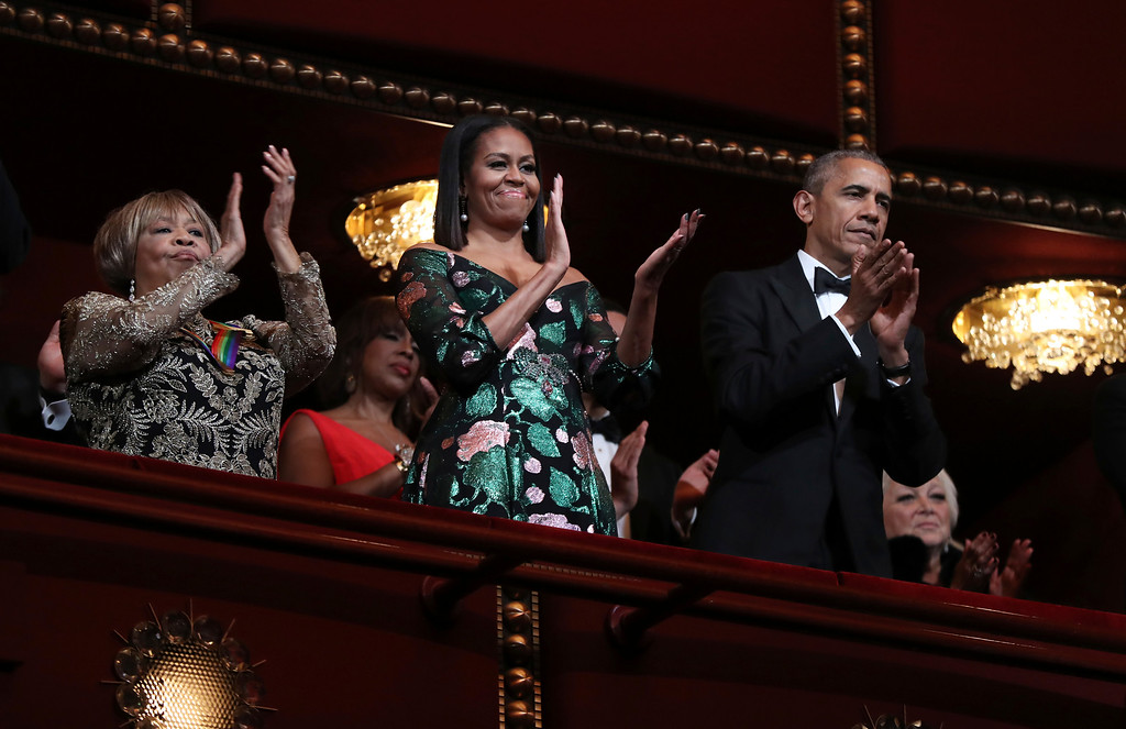 . President Barack Obama and first lady Michelle Obama, with recipient of the 2016 Kennedy Center Honor award blues singer Mavis Staples, applaud during the Kennedy Center Honors gala at the Kennedy Center in Washington, Sunday, Dec. 4, 2016. (AP Photo/Manuel Balce Ceneta)