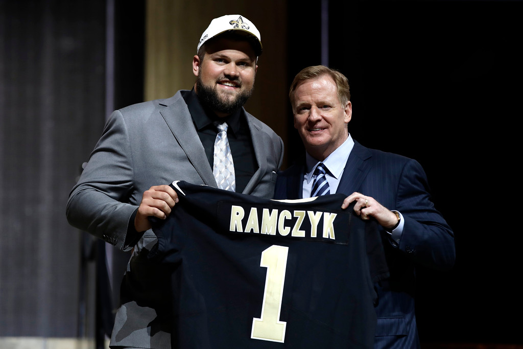 . Wisconsin\'s Ryan Ramczyk, left, poses with NFL commissioner Roger Goodell after being selected by the New Orleans Saints during the first round of the 2017 NFL football draft, Thursday, April 27, 2017, in Philadelphia. (AP Photo/Matt Rourke)