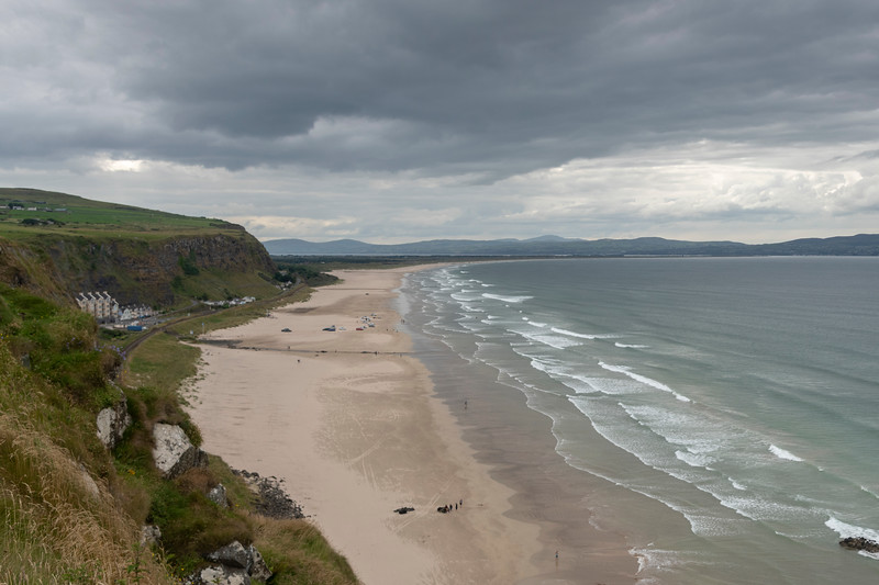 View of downhill beach and cliffs across Causeway Coastal Route, Northern Ireland, Ireland