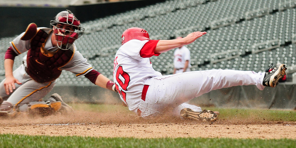 . Nebraska\'s Josh Scheffert slides past the tag of Minnesota catcher Matt Halloran to score in the fourth inning. (Pioneer Press: Ben Garvin)