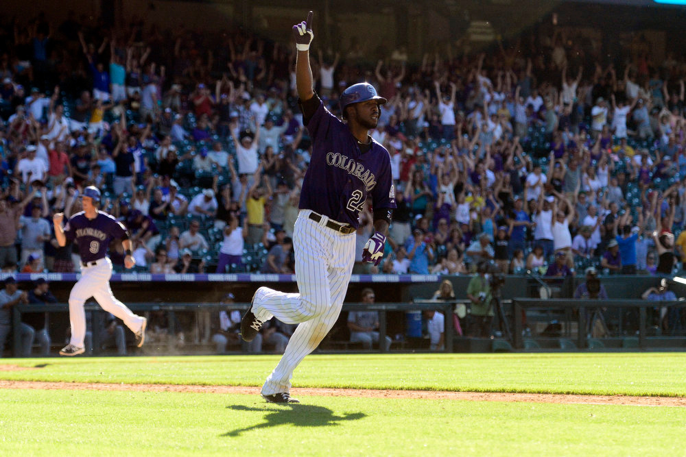 . DENVER, CO - JUNE 9: Colorado Rockies center fielder Dexter Fowler (24) celebrates his walk-off single as second baseman DJ LeMahieu (9) scores against the San Diego Padres during the 10th inning of the Rockies 8-7 win in Denver. The Colorado Rockies hosted the San Diego Padres. (Photo by AAron Ontiveroz/The Denver Post)