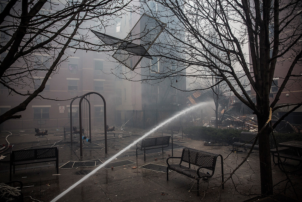 . Water is sprayed on smoldering debris from a two building collapse on March 12, 2014 in New York City.  (Photo by Andrew Burton/Getty Images)