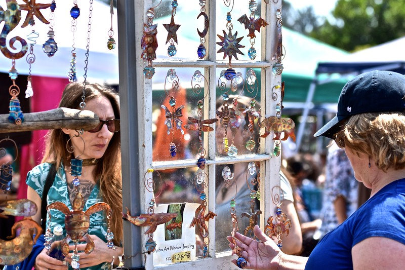 A window sill provides a view of decorative window hangers created by Ambrz Art of Arcata. José Quezada—For the Times-Standard