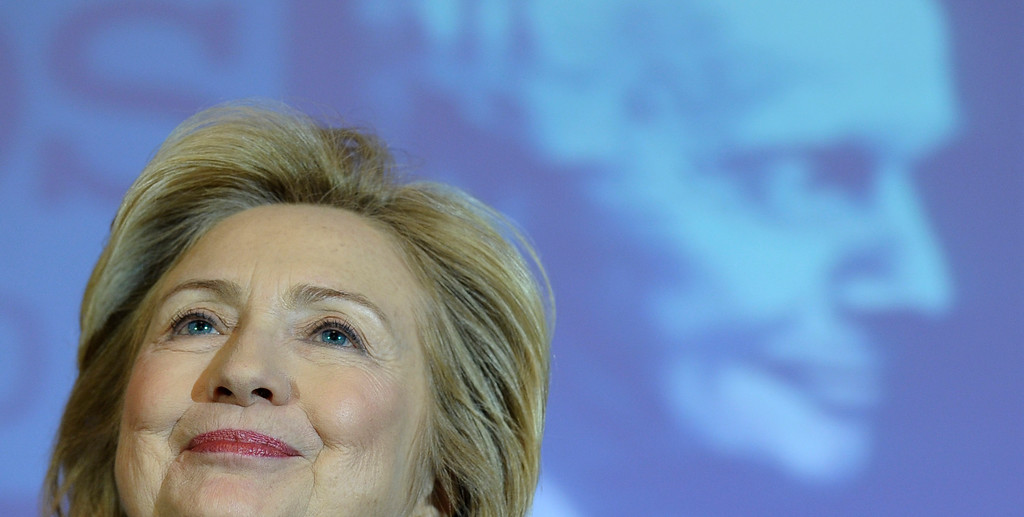 . Former Secretary of State Hillary Rodham Clinton speaks after receiving the 2013 Lantos Human Rights Prize during a ceremony on Capitol Hill in Washington, Friday, Dec. 6, 2013.  (AP Photo/Susan Walsh)