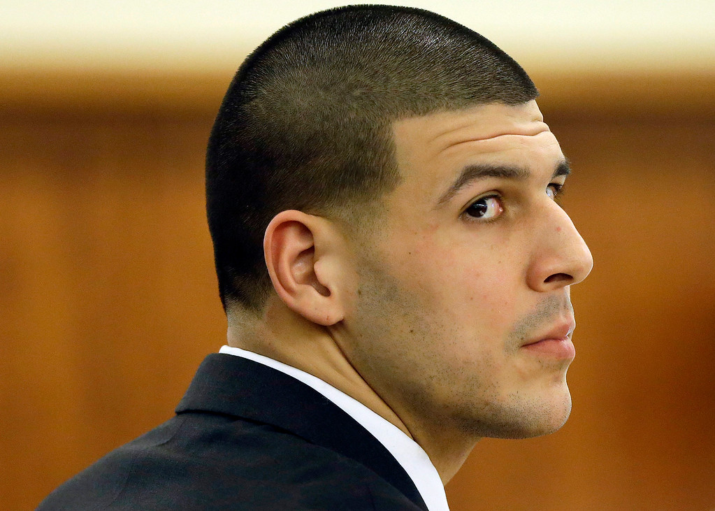 . Former New England Patriots football player Aaron Hernandez listens during his murder trial, Thursday, Jan. 29, 2015, in Fall River, Mass. Hernandez is charged with killing semiprofessional football player Odin Lloyd, 27, in June 2013.  (AP Photo/Steven Senne, Pool)