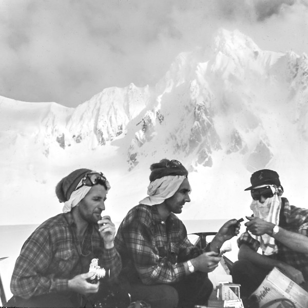 1956 Scoffing food after the air drop under Mt Douglas.jpg