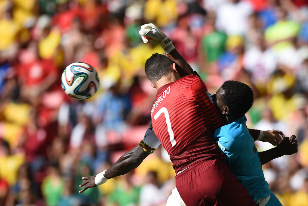 . Portugal\'s forward and captain Cristiano Ronaldo (L) and Ghana\'s goalkeeper Fatau Dauda vie during the Group G football match between Portugal and Ghana at the Mane Garrincha National Stadium in Brasilia during the 2014 FIFA World Cup on June 26, 2014. FRANCISCO LEONG/AFP/Getty Images
