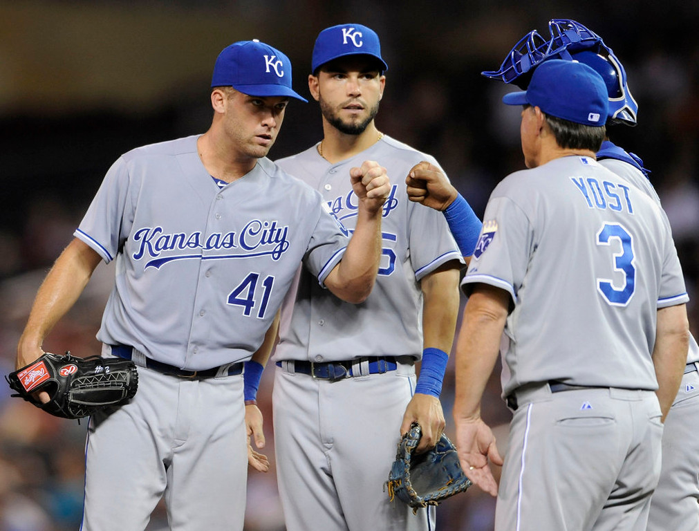 . Eric Hosmer #35 and Salvador Perez #13 of the Kansas City Royals congratulate starting pitcher Danny Duffy #41 as manager Ned Yost #3 takes Duffy out of the game against the Minnesota Twins during the seventh inning. (Photo by Hannah Foslien/Getty Images)