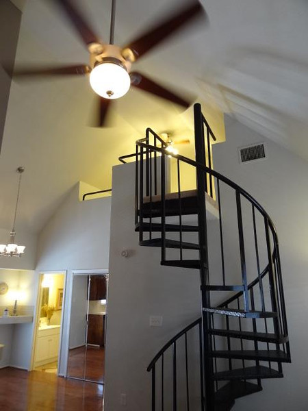 Looking up the staircase toward the loft.