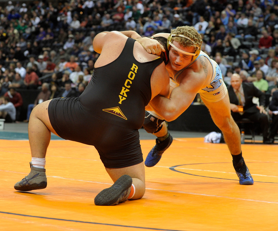 . DENVER, CO. - FEBRUARY 23: Greeley West senior Austin Waterman, right, tied up Rocky Mountain\'s Tony Martinez, left, in the 5A heavyweight championship match. The CHSAA State Wrestling Tournament wrapped up, February 23, 2013, with final matches following the Parade of Champions at the Pepsi Center in downtown Denver. (Photo By Karl Gehring/The Denver Post)