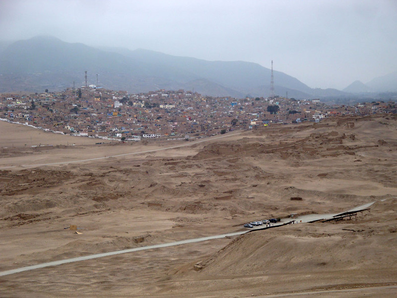 The new city (possibly a slum part) next to the old one, buried in the sands.