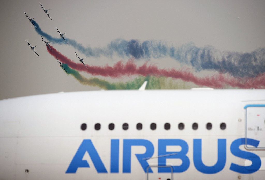 . The United Arab 1st Aerobatic team perform in their MB-339A jets perform next to an Airbus A380 jet at the Airshow China 2014 in Zhuhai, south China\'s Guangdong province on November 12, 2014.  The 10th Airshow China 2014 takes place from November 11 to 16.   AFP PHOTO / JOHANNES EISELE/AFP/Getty Images