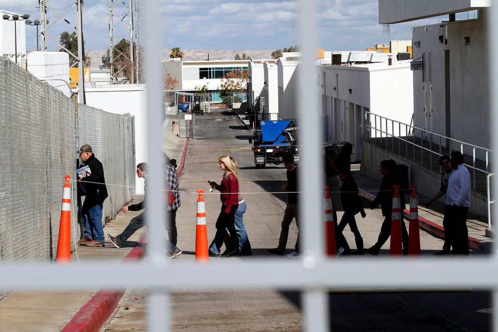 . Students are lead into the school\'s football stadium to be released to their waiting family members at Taft Union High School in Kern County, California, on Thursday, January 10, 2013, after a student opened fire in a classroom. (Irfan Khan/Los Angeles Times/MCT)