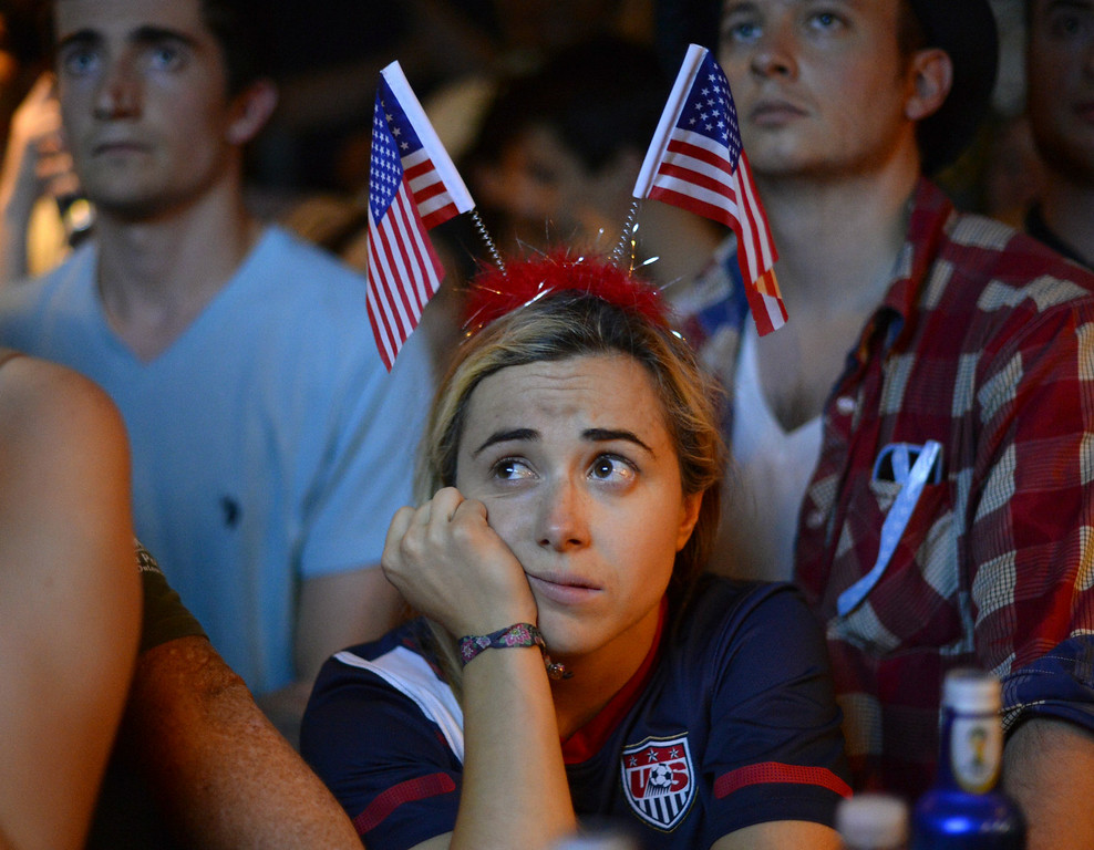 . Marisa Marcellino reacts as she watches the final minutes of the 2014 FIFA World Cup match between Belgium and USA from Jack Dempsey\'s Pub in New York on July 1, 2014. The US was defeated in extra time 2-1. AFP PHOTO / Timothy A. CLARY/AFP/Getty Images