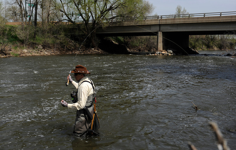 . Urban fishing on Monday, May 13, 2013 along the South Platte River near Overland Pond Park in Denver with John Davenport.  The W. Florida Ave bridge is in the background.  Photo By Cyrus McCrimmon/The Denver Post)