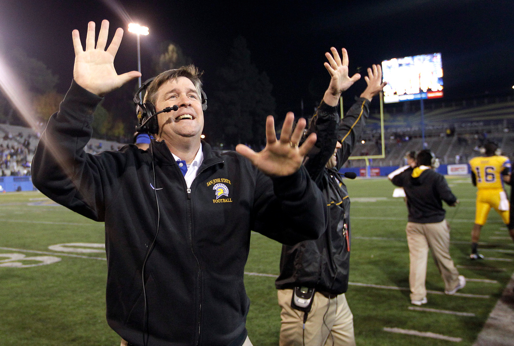 . San Jose State head coach Mike MacIntyre celebrates with the crowd the 52-43 win over Louisiana Tech during an NCAA college football game in San Jose, Calif., Saturday, Nov. 24, 2012. (AP Photo/Tony Avelar)
