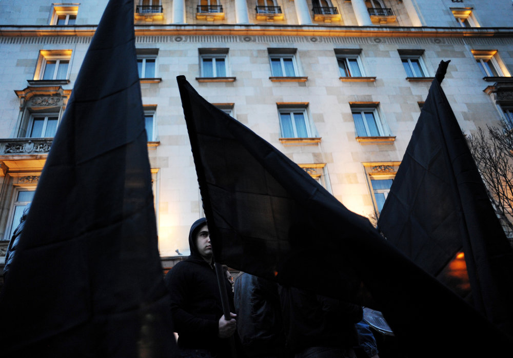 Description of . Members of nationalist organizations wave black flags in central Sofia on February 16, 2013. More than one thousand members of various nationalist organizations marched to commemorate General Hristo Lukov, a Bulgarian army commander from the World War I, who was killed on February 13, 1943. NIKOLAY DOYCHINOV/AFP/Getty Images