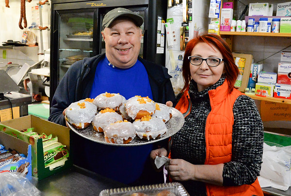 02/28/19 Wesley Bunnell | Staff Owners of Zieleniak Deli, Slawek Rulka, L and wife Beata Rulka stand with a tray of freshly made paczki on Fat Thursday.