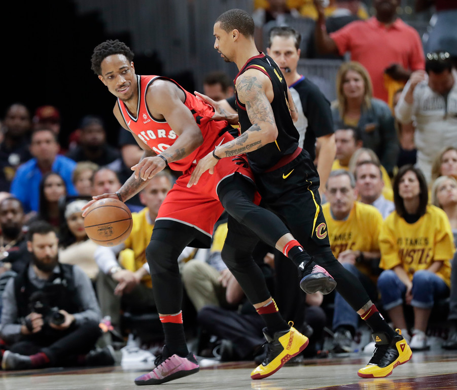. Toronto Raptors\' DeMar DeRozan attempts to drive on Cleveland Cavaliers\' George Hill in the first half of Game 4 of an NBA basketball second-round playoff series, Monday, May 7, 2018, in Cleveland. (AP Photo/Tony Dejak)