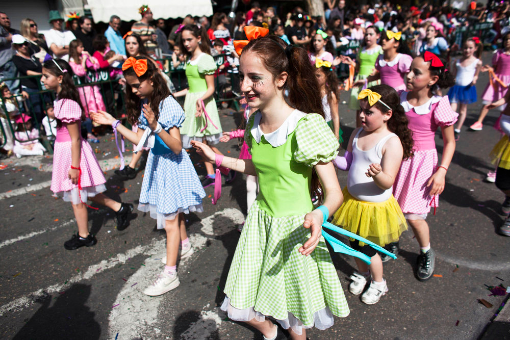 Description of . Girls dressed in costumes take part in an annual parade for the Jewish holiday of Purim, in the Israeli city of Holon, near Tel Aviv February 24, 2013. Purim is a celebration of the Jews\' salvation from genocide in ancient Persia, as recounted in the Book of Esther. REUTERS/Nir Elias
