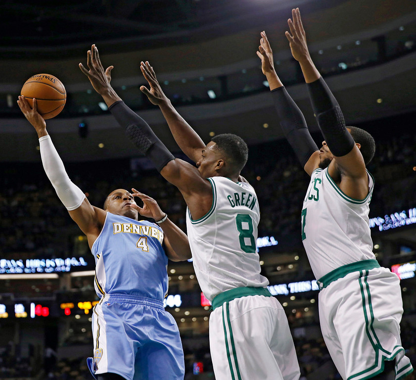 . Denver Nuggets\' Randy Foye (4) shoots against Boston Celtics\' Jeff Green (8) and Boston Celtics\' Jared Sullinger (7) in the first quarter of an NBA basketball game in Boston, Friday, Dec. 6, 2013. (AP Photo/Michael Dwyer)