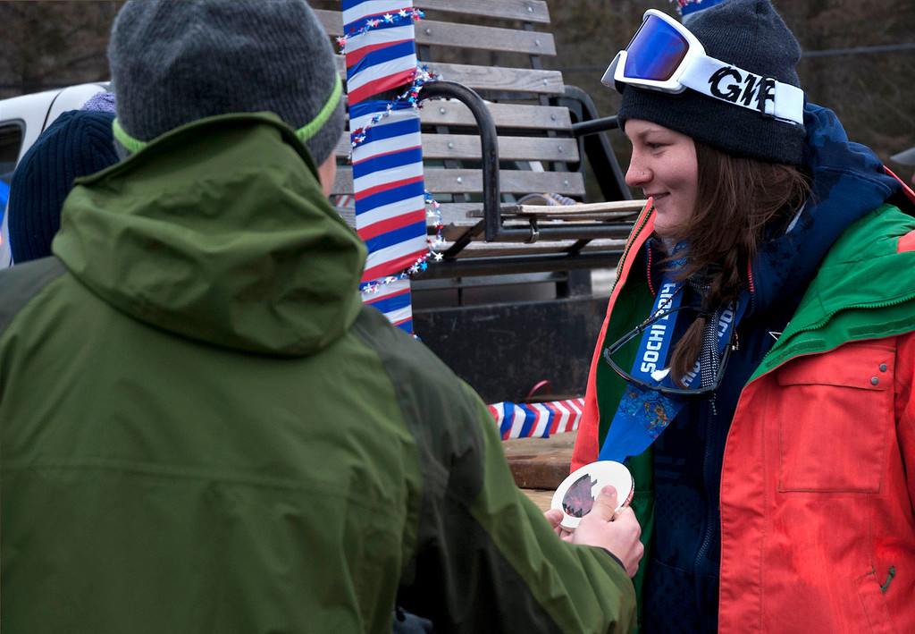 """. Kayla Rice/Reformer                                 Mount Snow athlete and Olympic silver medalist Devin Logan lets fans take a look at her silver medal during the \""""Devin Day\"""" celebration and parade in Dover on Saturday."""