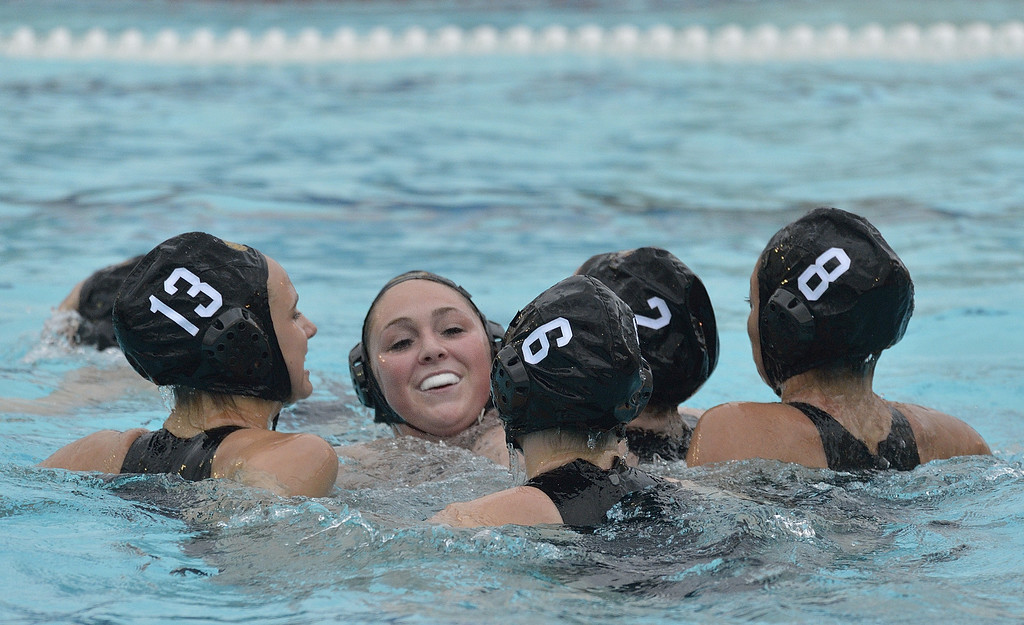 . LONG BEACH, CALIF. USA -- Wilson\'s Jessica King (13), Sarah Sheldon (5), Alana Gans (6), Alexis Angermund (2) and Maddie Carreon (8) celebrate their win over Poly in Long Beach, Calif., on February 7, 2013. Wilson defeated Poly, 6 to 5, to win the Moore League. Photo by Jeff Gritchen / Los Angeles Newspaper Group