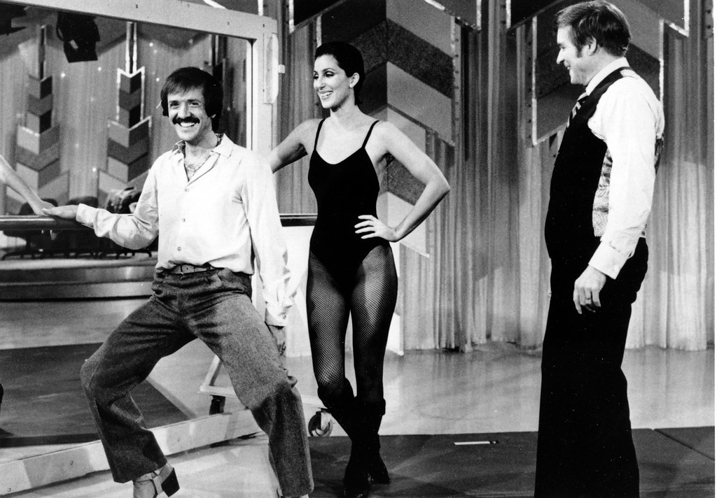 . Sonny Bono, left, and his ex-wife, Cher clown before Mike Douglas during the taping of the Mike Douglas Show in Los Angeles, Ca., Monday, Jan 23, 1979.  Cher co-hosts a week with Douglas to air beginning Feb. 26.  (AP Photo)
