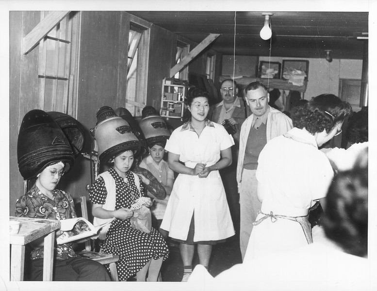 """""""Hair cuts are only $.20 each at this, one of several such beauty salons within the center.  Photo shows a small section of one of the large, modern, well-equipped salons.""""--caption on photograph"""
