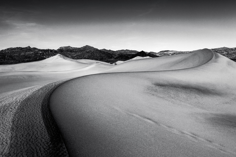 Curves This is an interesting shot of the Mesquite Dunes in Death Valley. The various colors in the sand creates some really unique patterns and designs along the ridges. It was a very new and challenging experience shooting here.