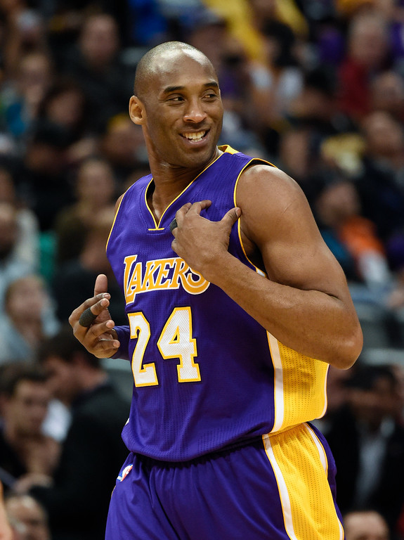 . DENVER, CO - MARCH 02: Los Angeles Lakers forward Kobe Bryant (24) smiles as he runs down the court against Denver Nuggets March 2, 2016 at Pepsi Center. This is Kobe\'s last game in Denver as he retires at the end of the season. (Photo By John Leyba/The Denver Post)