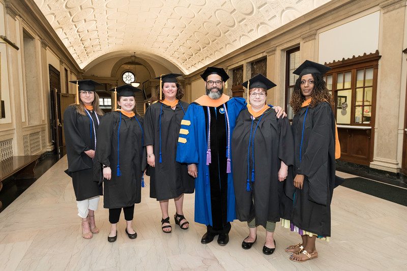 Professor McCabe [3R] poses with his students, l-r: Susan Murray, Katharine Schwartz, Alison Helzer, Cherri Witscheber and Sheniece Latoya Griffin. //  Graduates get ready in Lowry Hall before the ceremony. // University of Rochester School of Nursing Commencement, Kodak Hall at Eastman Theatre May 17, 2019.  // photo by J. Adam Fenster / University of Rochester