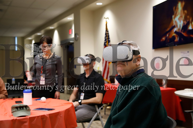 Navy veteran Chuck Jennnings tests out VR goggles at the Butler VA's stress relief workshop Thursday. Seb Foltz/Butler Eagle