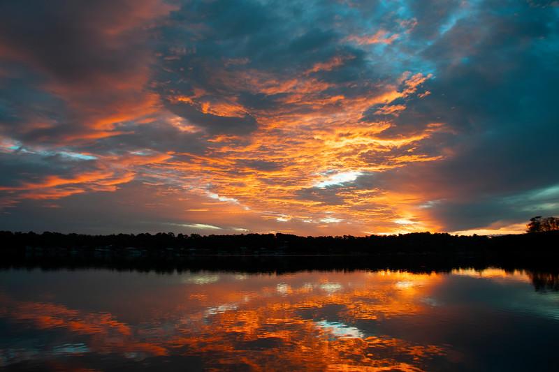 Orange stratocumulus cloudy coastal Sunrise Seascape. Australia