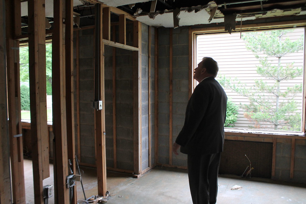 . State Representative John Rogers walks through the shell of a building that used to be the parish rectory at Saint Mary Magdalene\'s in Willowick. Demolition began on the rectory June 11. Kristi Garabrandt - The News-herald