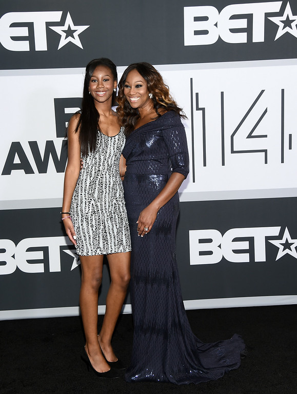 . Taylor Ayanna Crawford (L) and singer Yolanda Adams pose in the press room during the BET AWARDS \'14 at Nokia Theatre L.A. LIVE on June 29, 2014 in Los Angeles, California.  (Photo by Michael Buckner/Getty Images for BET)