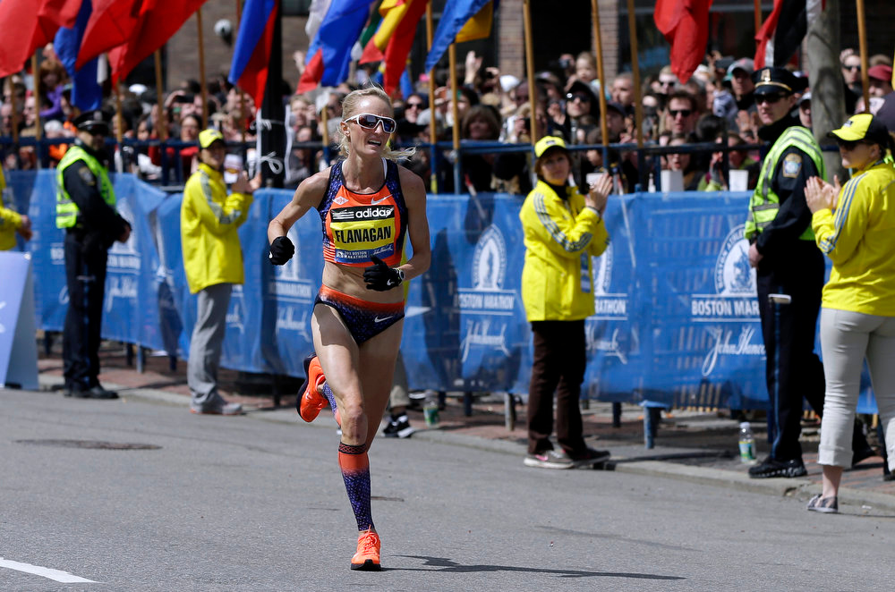 . Shalane Flanagan approaches the finish line to finish fourth in the women\'s division of the 2013 Boston Marathon in Boston Monday, April 15, 2013. (AP Photo/Elise Amendola)