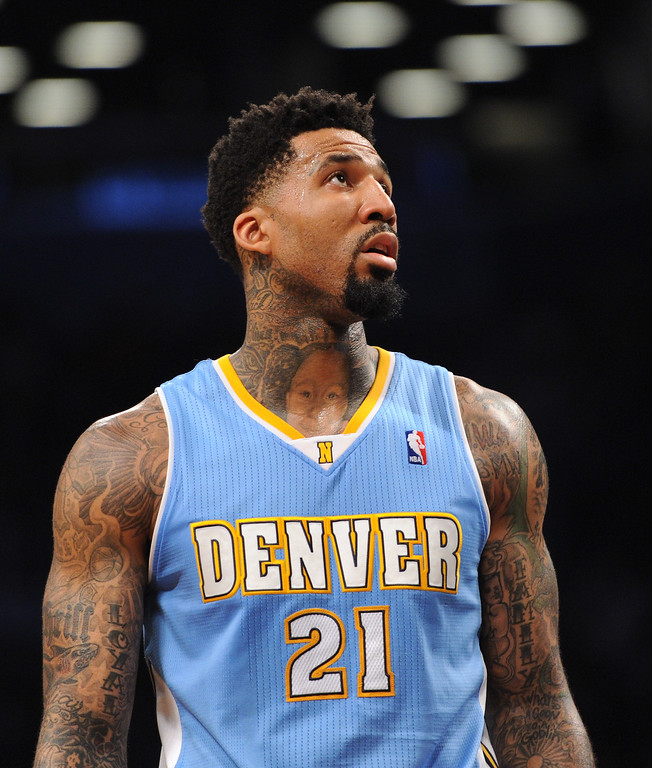 . NEW YORK, NY - DECEMBER 03:  Wilson Chandler #21 of the Denver Nuggets looks on during the second quarter against the Brooklyn Nets at Barclays Center on December 3, 2013 in the Brooklyn borough of New York City.  (Photo by Maddie Meyer/Getty Images)