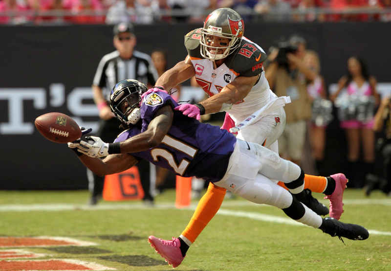 . Baltimore Ravens cornerback Lardarius Webb (21) breaks up a pass intended for Tampa Bay Buccaneers wide receiver Vincent Jackson (83) during the first half of an NFL football game in Tampa, Fla., Sunday, Oct. 12, 2014. (AP Photo/Steve Nesius)