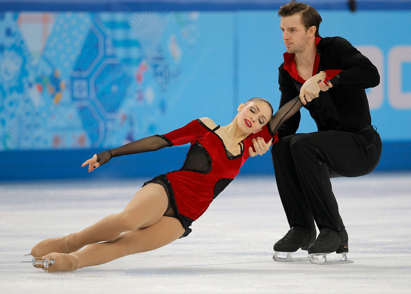 . Stefania Berton and Ondrej Hotarek of Italy compete in the pairs free skate figure skating competition at the Iceberg Skating Palace during the 2014 Winter Olympics, Wednesday, Feb. 12, 2014, in Sochi, Russia. (AP Photo/Vadim Ghirda)
