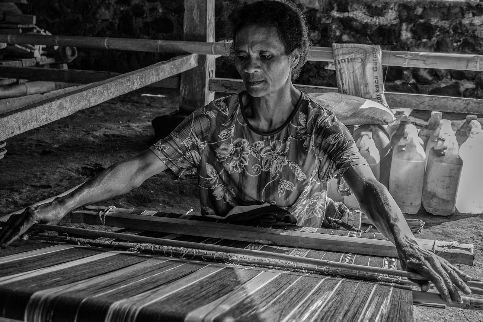 Luba Village Woman Weaving an Ikat