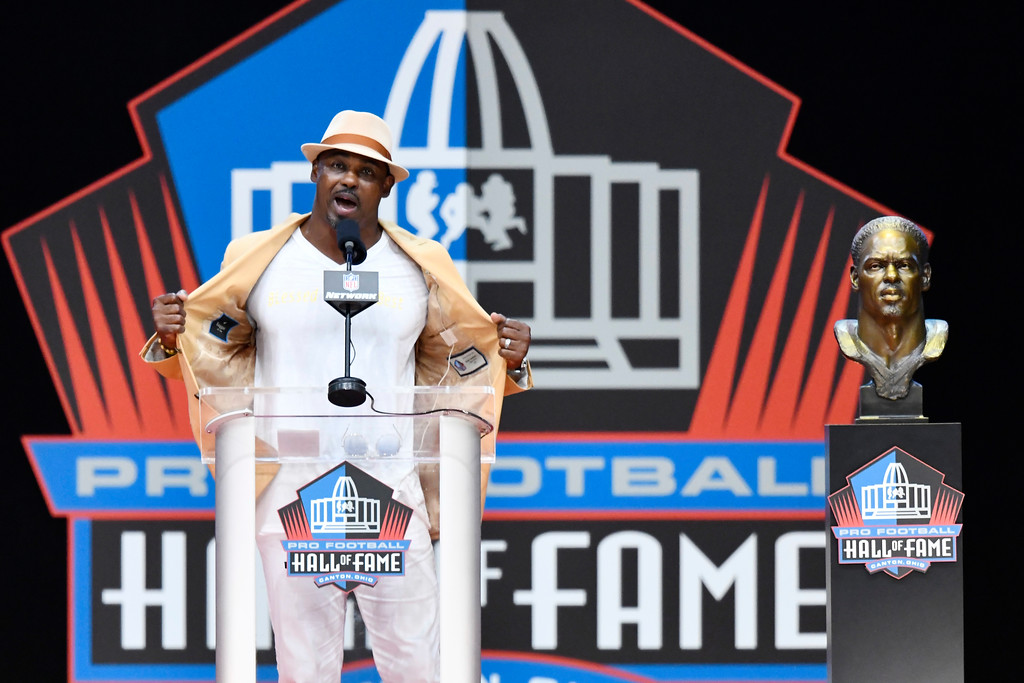 . Former NFL safety Brian Dawkins delivers his induction speech at the Pro Football Hall of Fame on Saturday, Aug. 4, 2018, in Canton, Ohio. (AP Photo/David Richard)