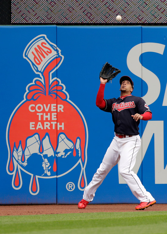 . Cleveland Indians\' Michael Brantley catches a ball hit by Kansas City Royals\' Abraham Almonte in the fifth inning of a baseball game, Saturday, May 12, 2018, in Cleveland. Almonte was out on the play, (AP Photo/Tony Dejak)
