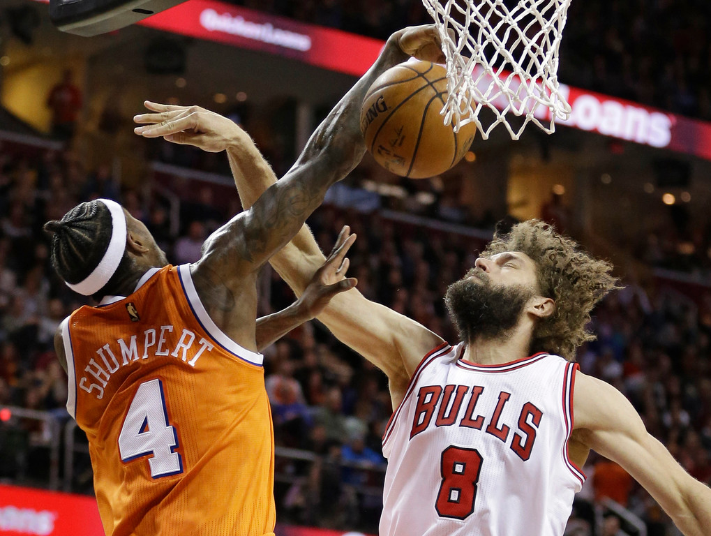 . Chicago Bulls\' Robin Lopez (8) fouls Cleveland Cavaliers\' Iman Shumpert (4) in the first half of an NBA basketball game, Wednesday, Jan. 4, 2017, in Cleveland. (AP Photo/Tony Dejak)