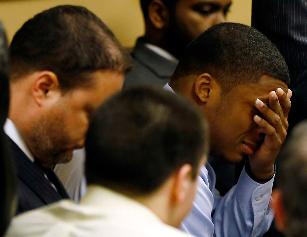 . Ma\'lik Richmond (R) reacts as the verdict is read in the juvenile court in Steubenville, Ohio March 17, 2013. Two high school football players from Ohio, Trent Mays (white shirt, back to camera), 17, and Richmond, 16, were found guilty of raping a 16-year-old girl at a party last summer while she was in a drunken stupor in a case that gained national exposure through social media. REUTERS/Keith Srakocic/Pool
