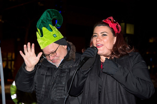 12/05/19 Wesley Bunnell | StaffrrThe New Britain Christmas tree was lit on Thursday night in Central Park complete with a visit from Santa Clause who rode in on a NBFD fire truck. Mayor Erin Stewart announces the &quote;number one elf&quote; Downtown District Executive Director Gerry Amodio .